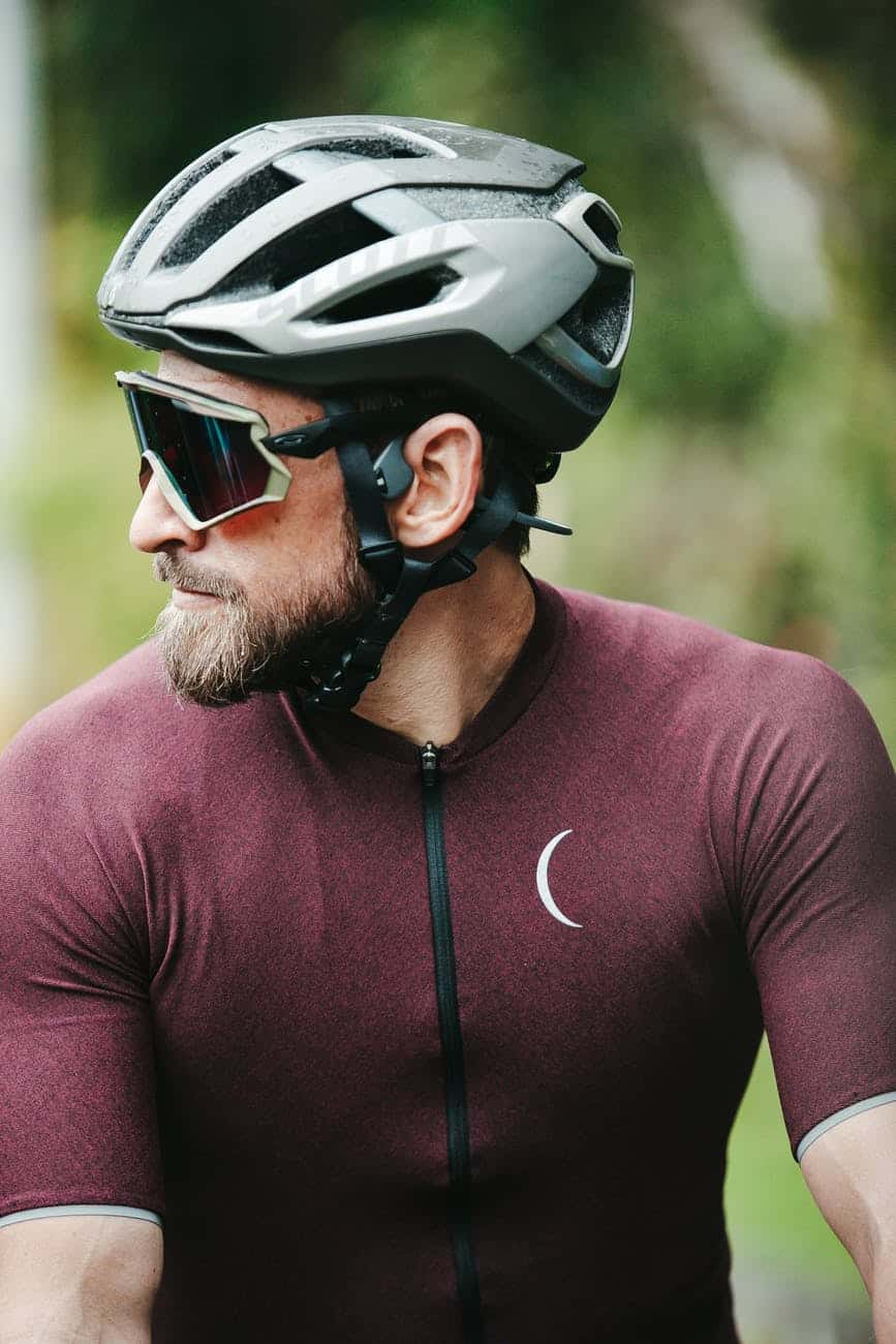 bearded sportsman in helmet and cycling glasses