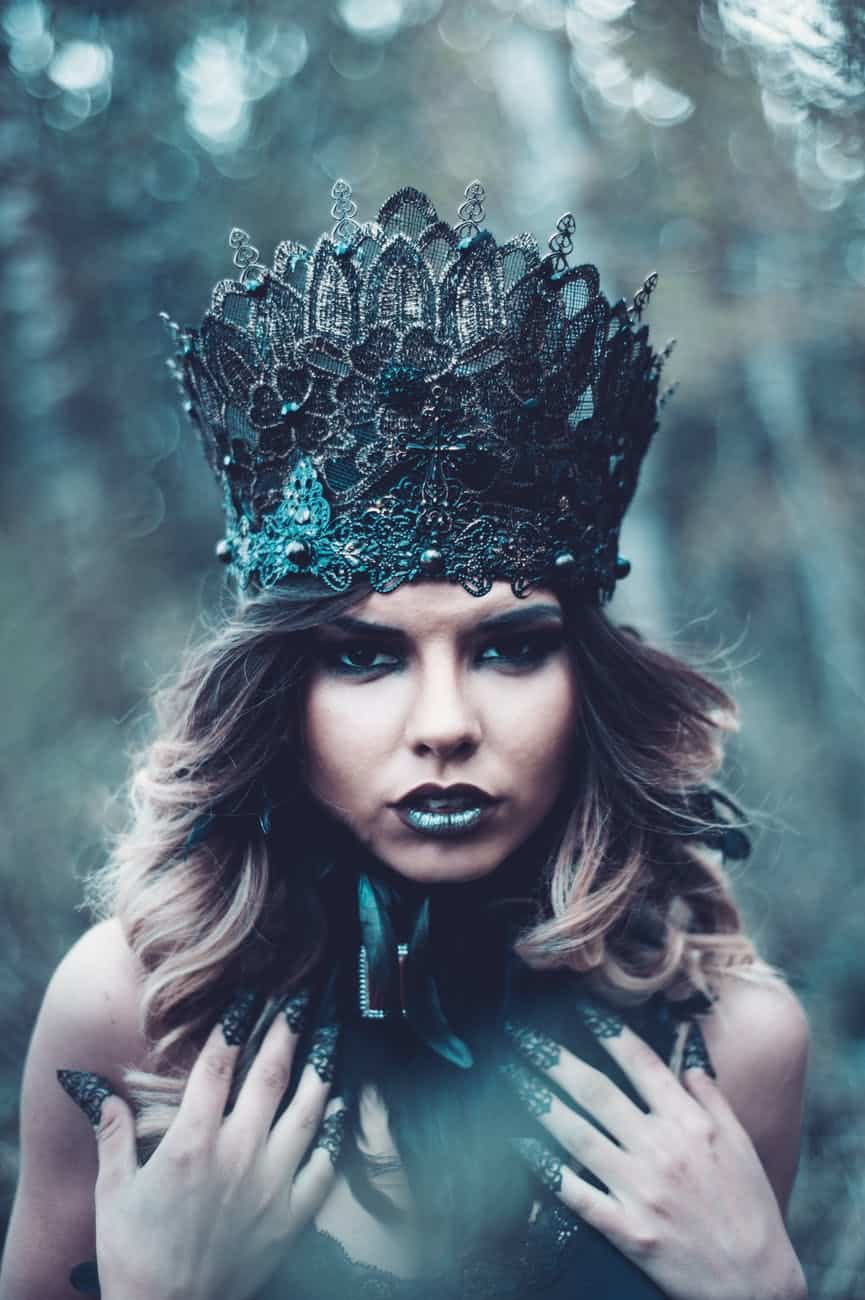 greyscale photography of woman wearing crown