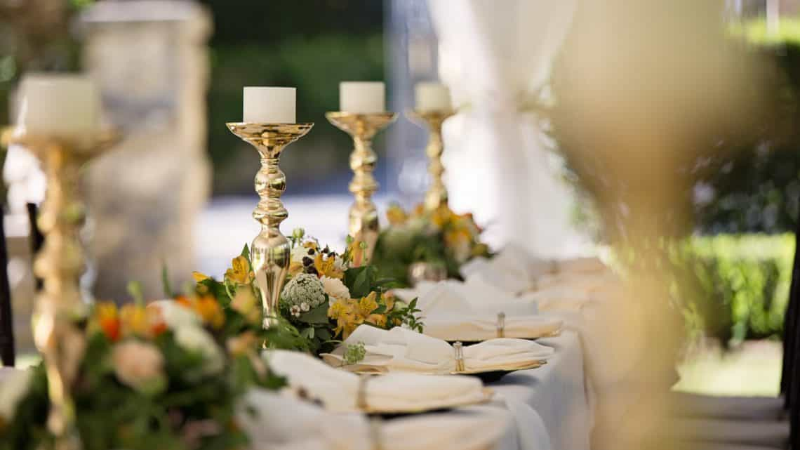 selective focus of candlesticks on table with wedding set up
