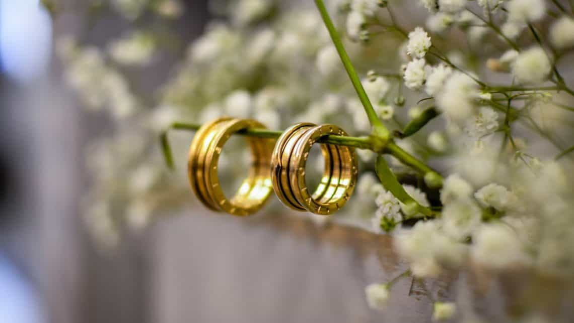 close up photo of gold wedding rings